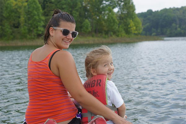 Our daughter and our au pair out on a canoe ride.