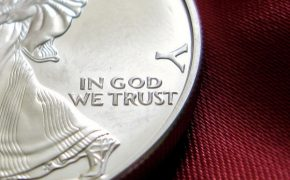'In God We Trust' Police Car Bumper Sticker Reignites the Debate of Church and State