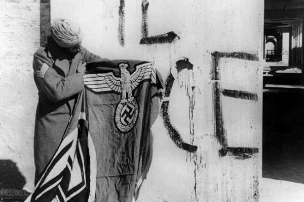 Sikh soldier with captured Swastika flag See page for author [Public domain], via Wikimedia Commons