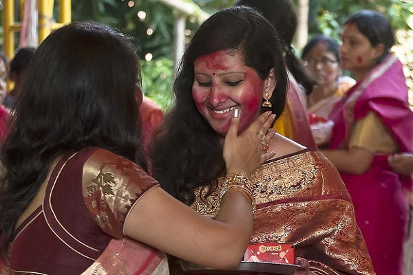 What's the Significance of the Red Powder Hindu Women Wear on Their Heads?