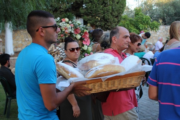 In the end of the service, the worshippers receive small pieces of bread that have been blessed by the priest.