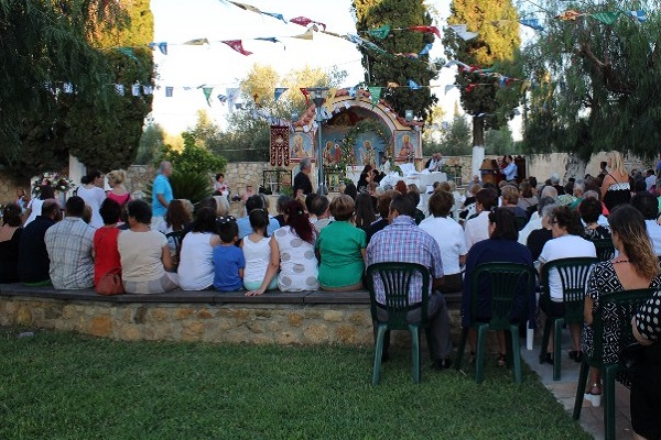 Believers stand in the courtyard or bring their own chairs to attend the service.
