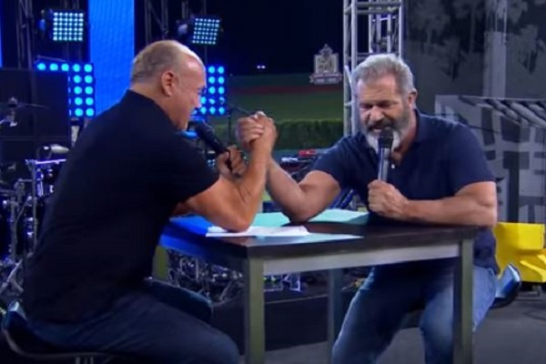 "Pastor Greg Laurie challenges Mel ""big guns"" Gibson to an armwrestling match at SoCal Harvest 2016 Video screenshot"