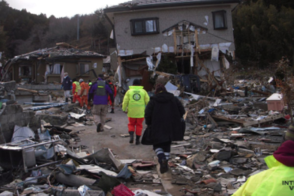 The bright yellow jackets of the Volunteer Ministers brought help after the 2011 tsunami in Japan.