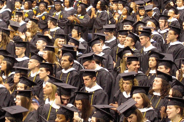 By Kit from Pittsburgh, USA (Grads Absorb the News) [CC BY 2.0], via Wikimedia Commons