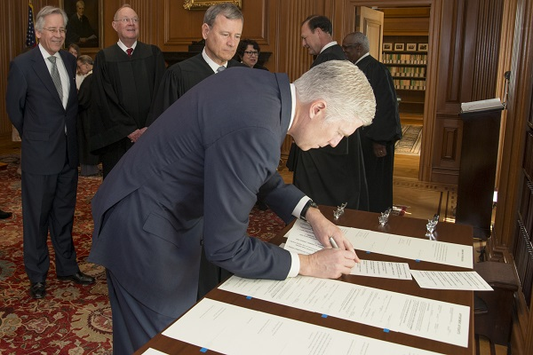 Judge Neil M. Gorsuch signs the Constitutional Oath in the Justices' Conference Room, Supreme Court Building -April 10, 2017.