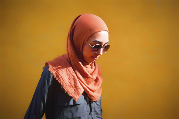 woman wearing hijab and sunglasses