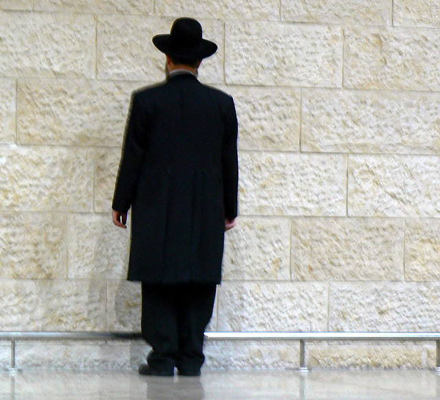 Rabbi facing wailing wall