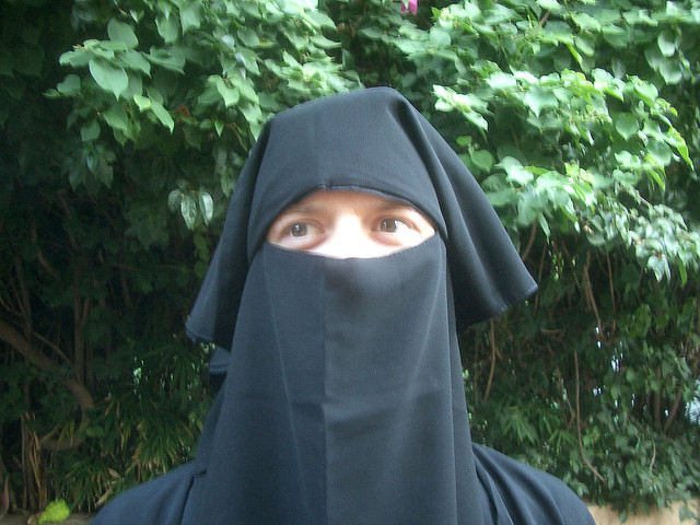 White woman wearing burka