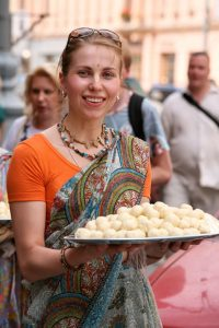 "A Russian Hare Krishna with a plate of ""prasadam,"" or ""food sanctified by the Lord."""