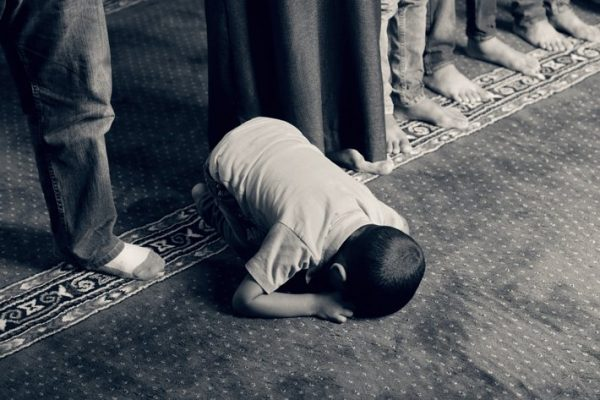 A child prays.