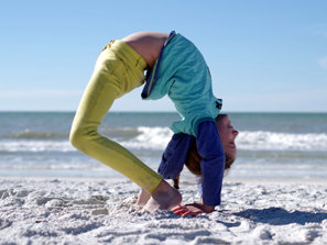 Mackenzie doing gymnastics at the beach