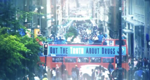 "Double-decker bus with ""Truth About Drugs"" banner: What is Scientology? Super Bowl Ad 2018"