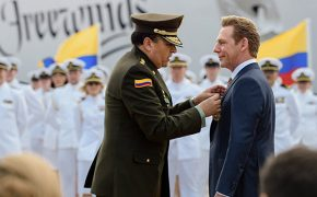 David Miscavige is presented with a medal by General Carlos Ramiro Mena Bravo.