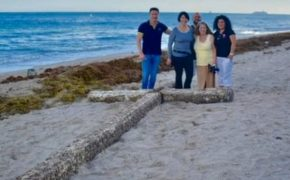 A 20-Ft Barnacle Covered Wooden Cross Washed Up on Ft. Lauderdale Beach