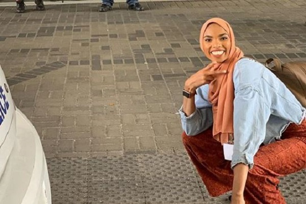 Muslim Woman Smiles in the Face of Bigotry
