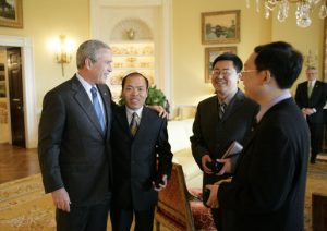 President George W. Bush meets with Chinese Human Rights activists, from left:  Li Baiguang,  Wang Yi, and Yu Jie in the Yellow Oval Room of the White House.